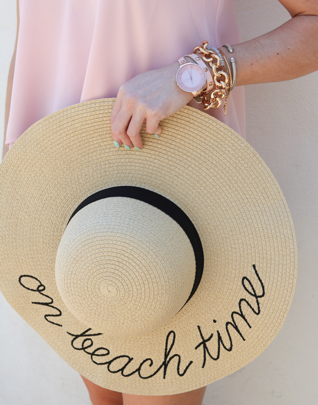 blush studded watch and gold link bracelet with pink cami and sun hat