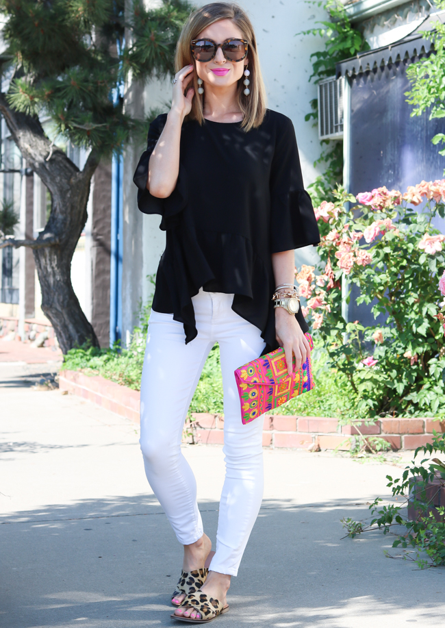black ruffle top white skinny jeans bright pink clutch leopard sandals