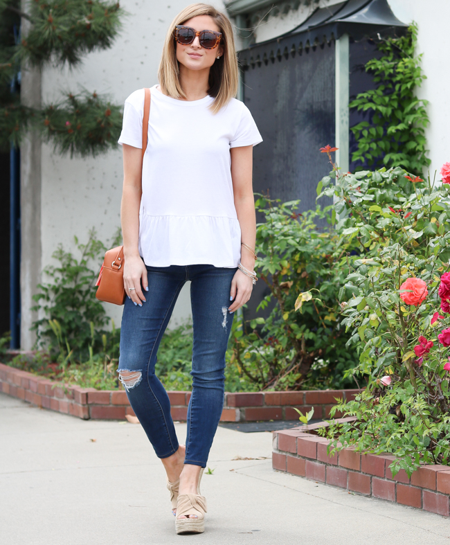 simple white peplum tee with distressed skinny jeans and bow mules