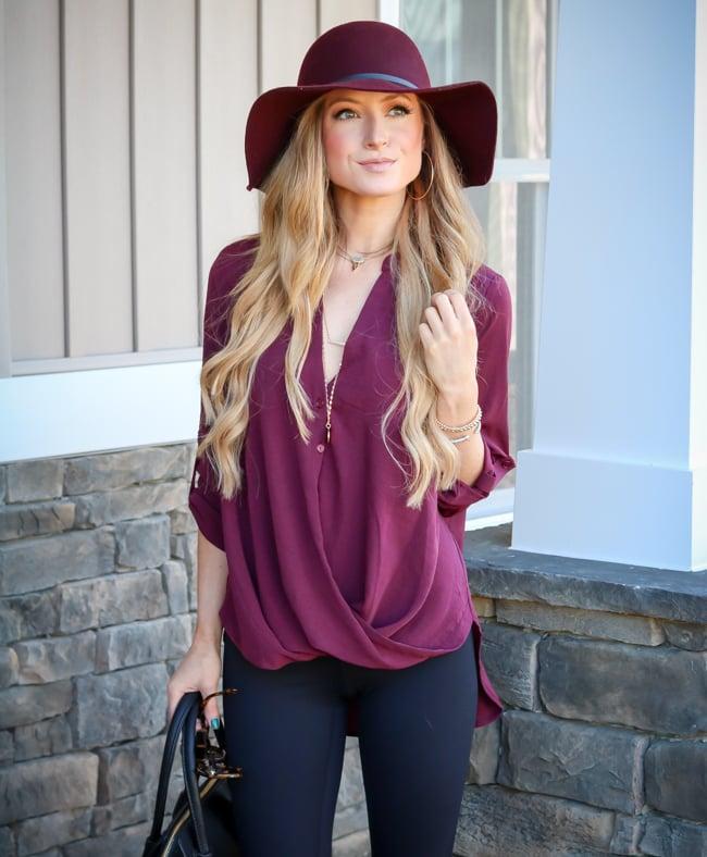 floppy hat burgundy tunic black leggings