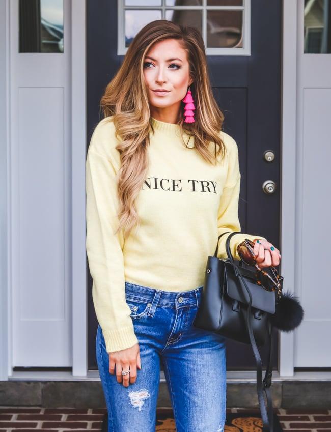 na-kd yellow sweater ag boyfriend jeans pink baublebar tassel earrings
