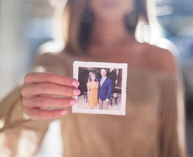 holding photo of couple
