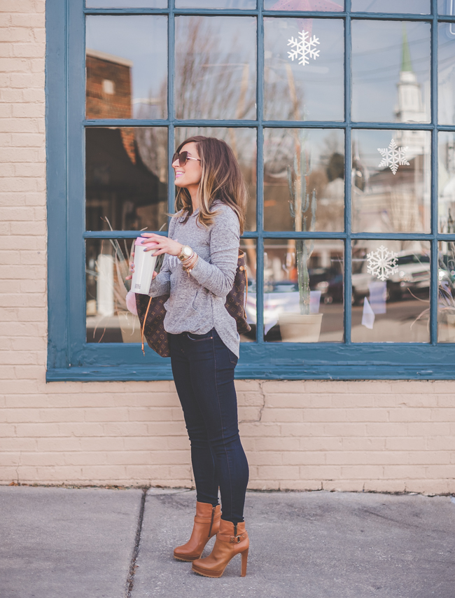 holding coffee tumbler in mott & bow jeans