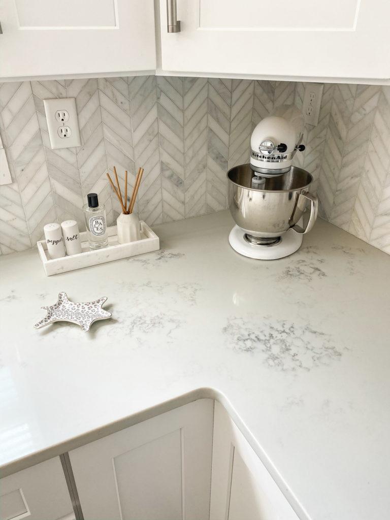 white kitchenaid on white marble counter