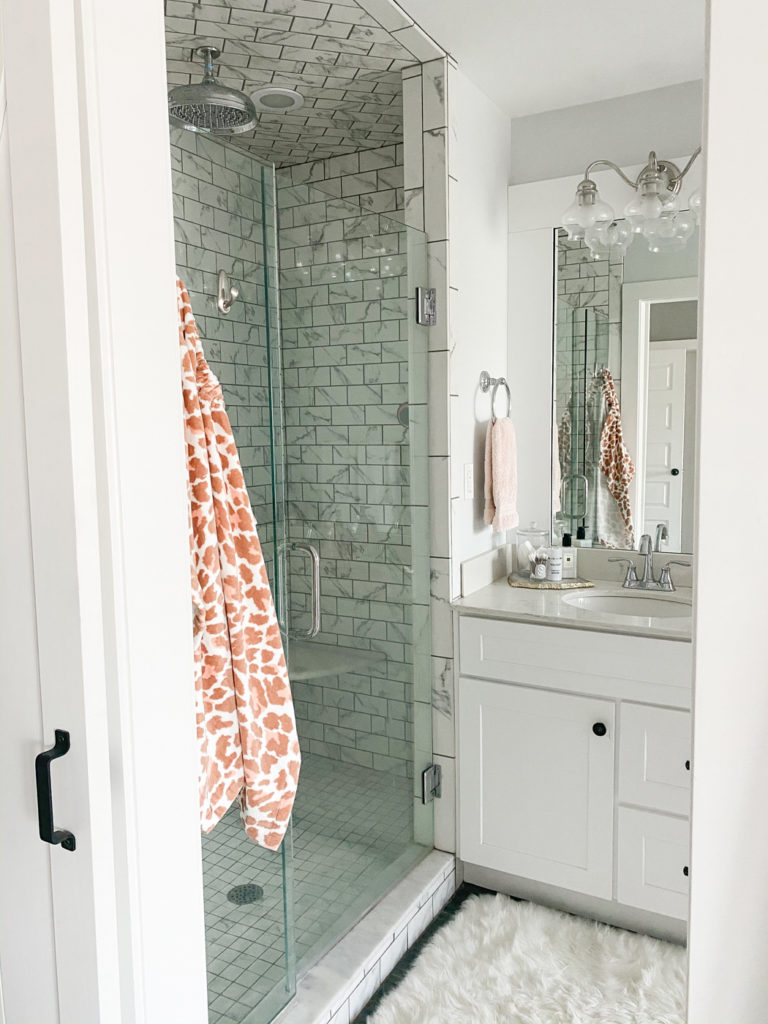 all white master bathroom